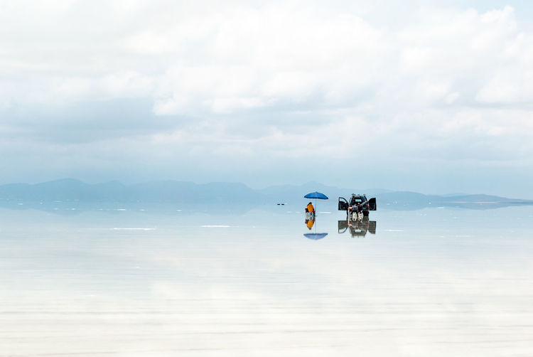 Lunch time reflexions Reflection Uyuni Beauty In Nature Cloud - Sky Day Mode Of Transport Nature Outdoors People Real People Salar De Uyuni Scenics Sea Sky Transportation Water