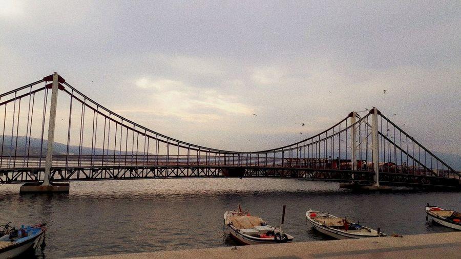 """dingin saatler"" City Water Suspension Bridge Bridge - Man Made Structure River Bridge Nautical Vessel Sky Architecture Built Structure"