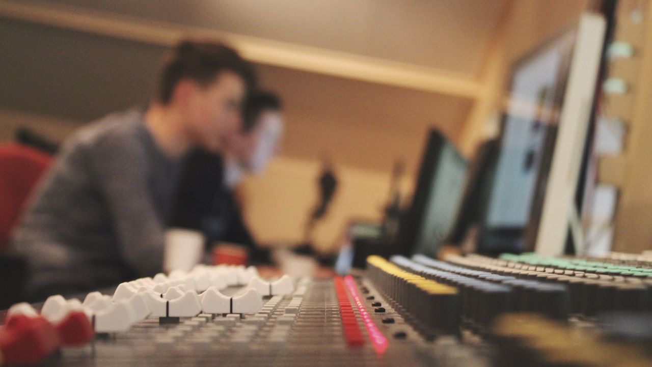music, recording studio, technology, sound recording equipment, indoors, sound mixer, real people, musical instrument, arts culture and entertainment, mixing, occupation, men, one person, radio station, close-up, young adult, people