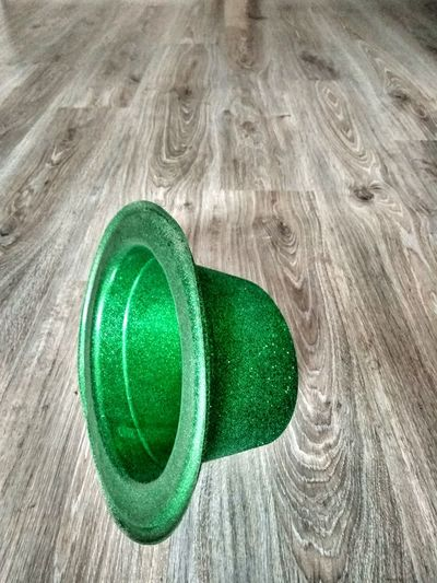 Green Color No People Close-up Indoors  Christmas Ornament Day Party Party Is Over Hat Green Hat The Day After Ground Wooden Parquet Wood Alone Fun Nobody St. Patrick's Day Saint Patrick's Day Saint Patrick Good Vibrations Real Life Magazine Colorful Contrast Break The Mold