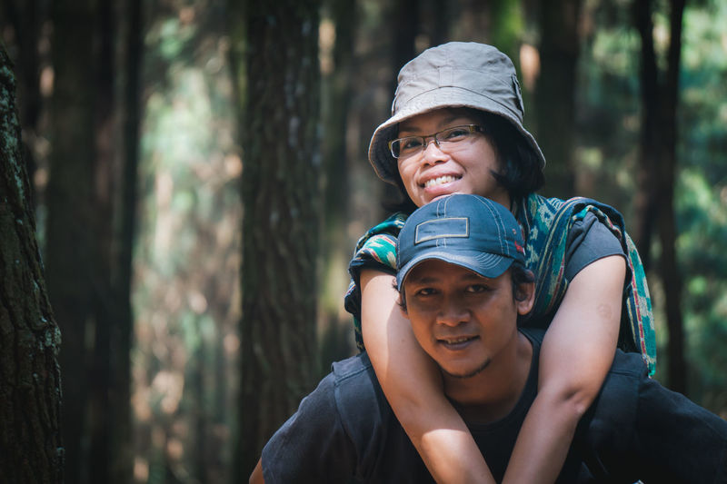 Portrait of happy smiling couple in forest