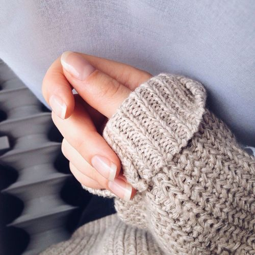 Cropped Image Of Woman Wearing Sweater