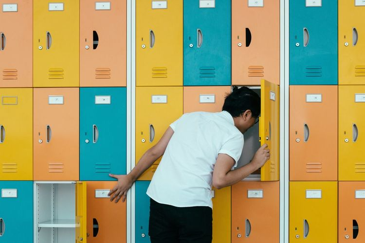 The hunt - Locker Locker Room In A Row Indoors  Men One Man Only One Person Sports Clothing Adult People Adults Only Occupation Only Men Day Hunt Block Colors Pattern EyeEm Best Shots My Year My View Eye4photography  Find Searching Ideas