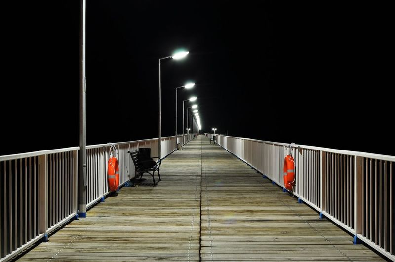 take me to nowhere EyeEmNewHere Sea Water Seascape Seaside Calm Night Red City Illuminated Outdoors No People Railing The Way Forward Lighting Equipment Street Light Walkway Architecture Sky
