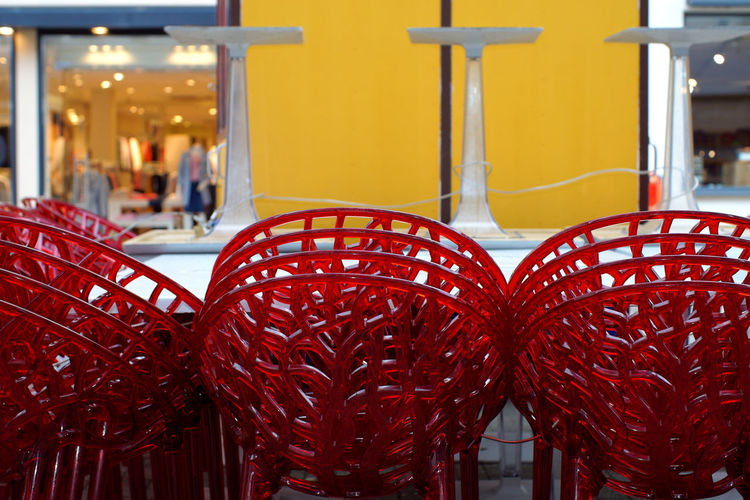 Red ice Red Focus On Foreground Close-up No People Still Life Table Business Restaurant Pattern Seat Yellow Chair Arrangement Day In A Row Retail  Glass Group Of Objects Stacked