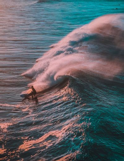 High angle view of person surfing on waves