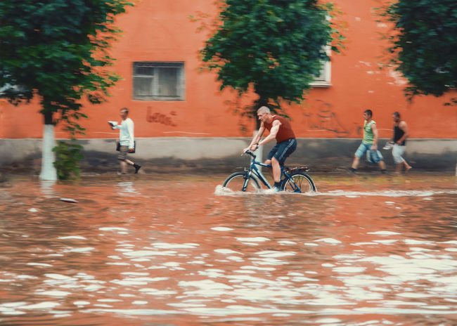 Global warming? Are you ready? / The city against nature 7 Bicycle Transportation Reflection Water Outdoors Full Length Mode Of Transport Cycling Men Tree City Day People Young Adult Adults Only Adult Food The Flood Blurred Blurred Motion Adapted To The City Captured Moment captured in 2007, but nothing is change in this place... The Photojournalist - 2017 EyeEm Awards