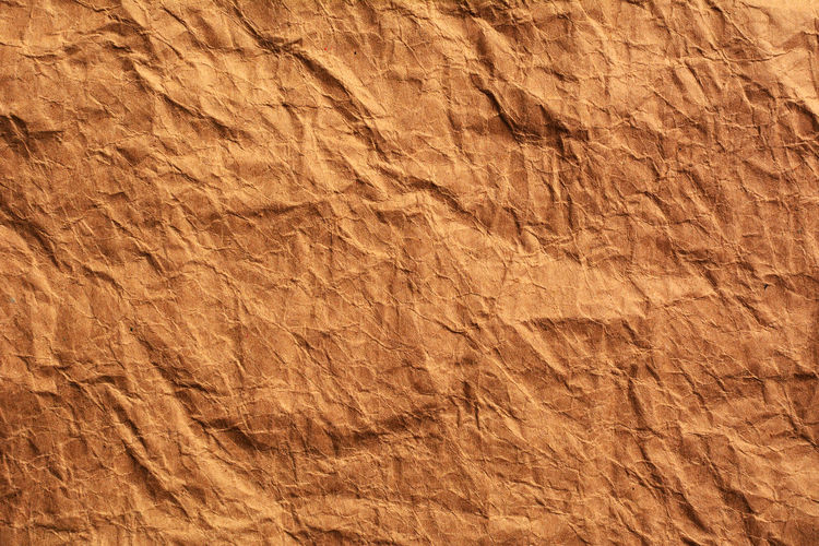 Full Frame Shot Of Brown Crumbled Paper
