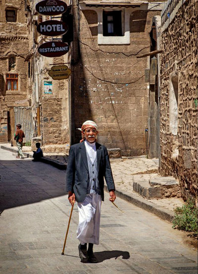Building Exterior Architecture One Person Adult Built Structure Looking At Camera Portrait Front View City Senior Adult Full Length Street Day Real People Lifestyles Clothing Glasses Males  Smiling Outdoors