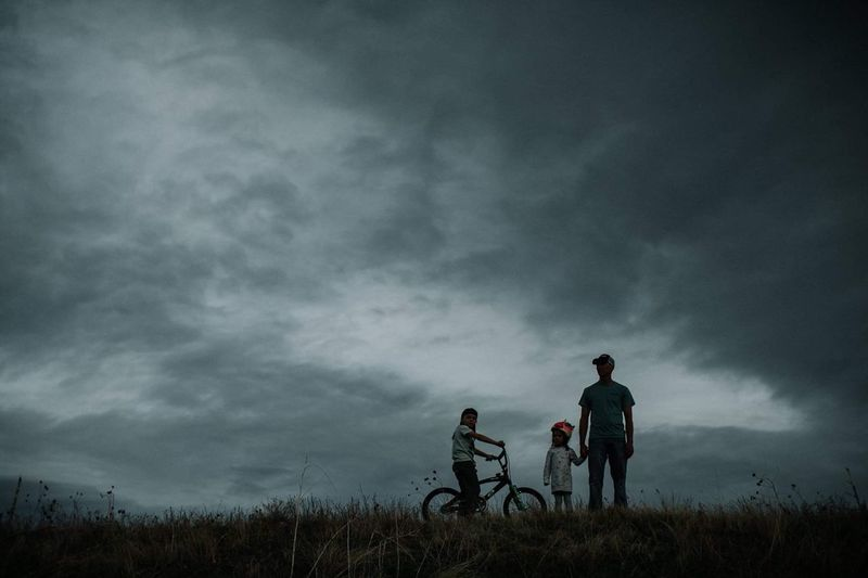 Our adventure Cloud - Sky Two People Sky Overcast Bicycle Weather Leisure Activity Mode Of Transport Storm Cloud Real People Outdoors Nature Full Length Men Landscape Field Land Vehicle Adventure Friendship Bonding Silhouette Resist