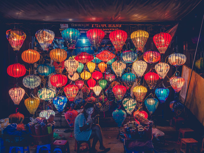 Lighting Equipment Illuminated Lantern Hanging Large Group Of Objects Decoration Chinese Lantern Real People Multi Colored Night Adult Women Abundance Choice Variation Group Of People Lifestyles Indoors  People Light Festival Electric Lamp