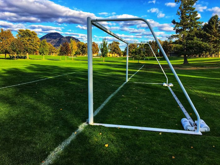 Soccer closeup Grass Sport Green Color Tree Day Playing Field Cloud - Sky Golf Course Beauty In Nature Golf No People Green - Golf Course Outdoors Competitive Sport Sky Goal Post Nature Soccer Field