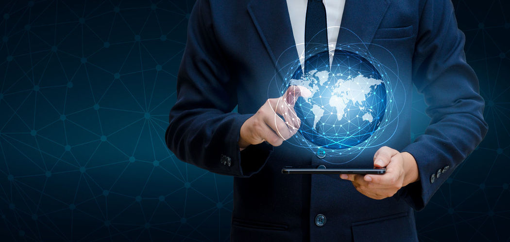 Adult Bright Business Business Person Crystal Ball Futuristic Globe - Man Made Object Glowing Holding Human Hand Illuminated Indoors  Light - Natural Phenomenon Men One Person Screen Shape Sphere Suit Technology Transparent World World Map World Map Exploring World Map On Ceilling