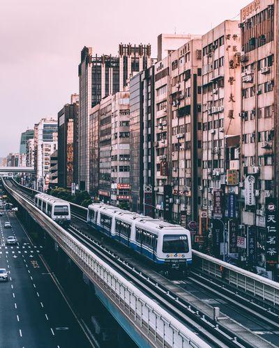 Train on city against sky