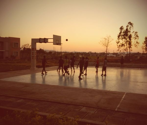 Game of Basketball College College Life Basketball Basketball - Sport Basketball Game Sport Evening Sky Evening Evening Light Playing Basketball Player Enjoying Life Good Times Mobilephotography Mobile Photography Low Light Candid Ball Sky Sunset Men Togetherness Silhouette Competition Sky Autumn Mood