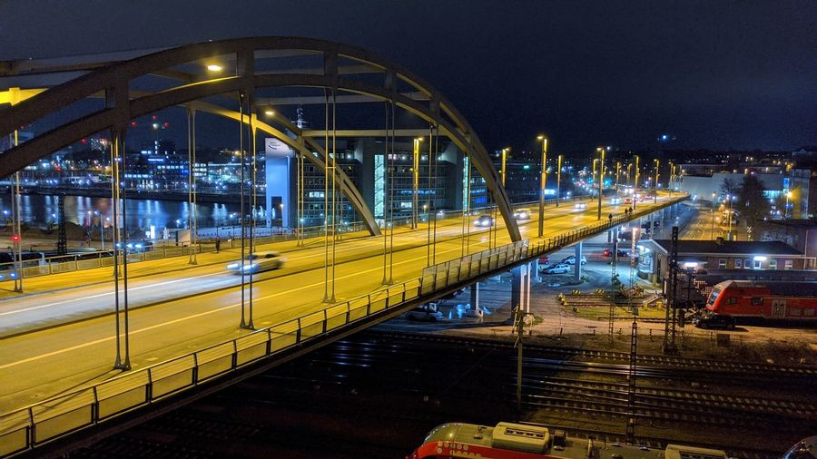 View of bridge in city at night