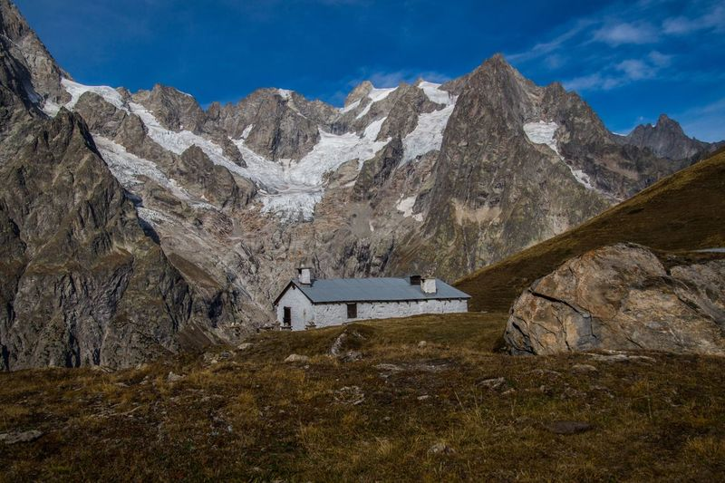 mallatra,val ferret,courmayeur,italy Mountain Mountain Range Scenics - Nature Nature Landscape Sky Environment Beauty In Nature No People Day Land Rock Plant Snow Solid Outdoors Architecture Tranquility Rock - Object Tranquil Scene Mountain Peak