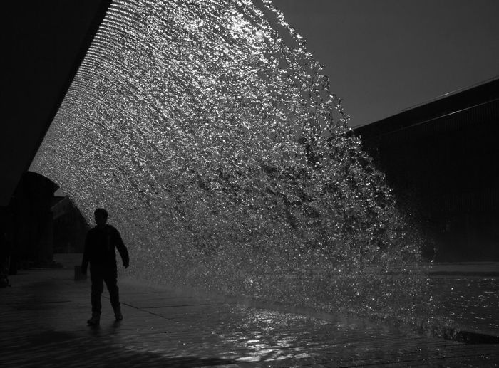 43 Golden Moments Lisbon Streetphotography Waterfall B&w Photography One Person Black And White Backlight Architecture Darkness And Light Behindthescenes Splash