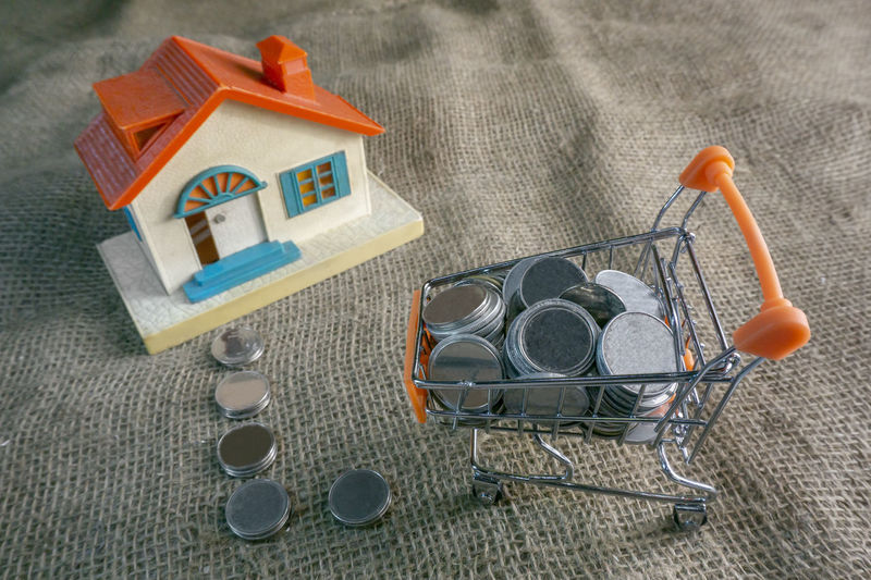 Architecture Art And Craft Building Built Structure Close-up Coins Day Equipment High Angle View Home Home Ownership House Indoors  Multi Colored Nature No People Orange Color Saving Money Small Still Life