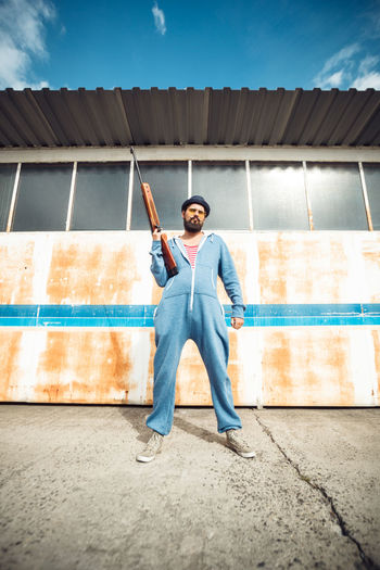 Gun Hunter Man Shoot Stripes Target Airgun Beard Casual Clothing Day Front View Full Length Hipster Jumpsuit Leisure Activity One Person Onsie Outdoors Pose Pyjama Riffle Standing Weapon Young Adult Young Men