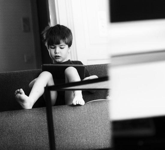Man looking at camera while sitting at home