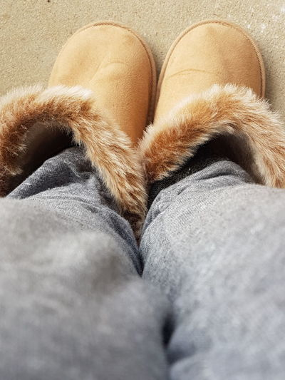 Keeping warm Winter Cold Keeping Warm Slippers Ugg Boots Fluffy Legs Feet Close Up Freezing Always Be Cozy