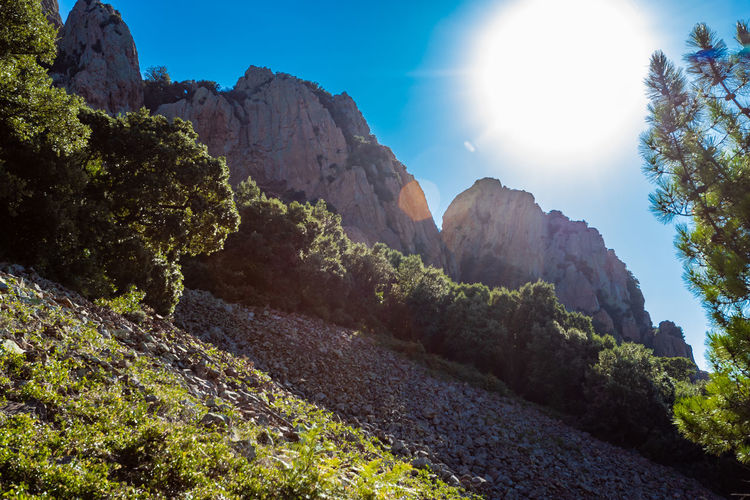 Beauty In Nature Day Environment Formation Land Lens Flare Mountain Mountain Range Nature No People Non-urban Scene Outdoors Plant Rock Rock - Object Rock Formation Scenics - Nature Sky Solid Sun Sunlight Tranquil Scene Tranquility Tree