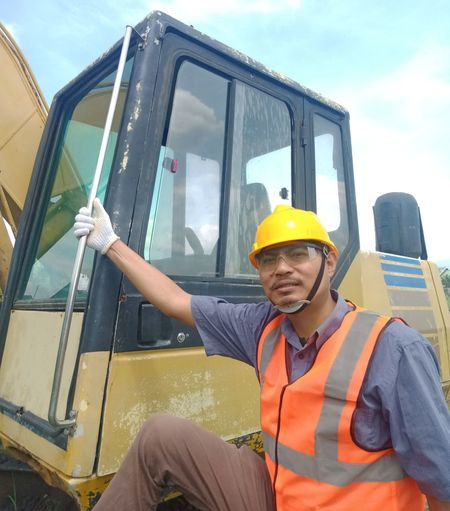 Rear view of man working against yellow
