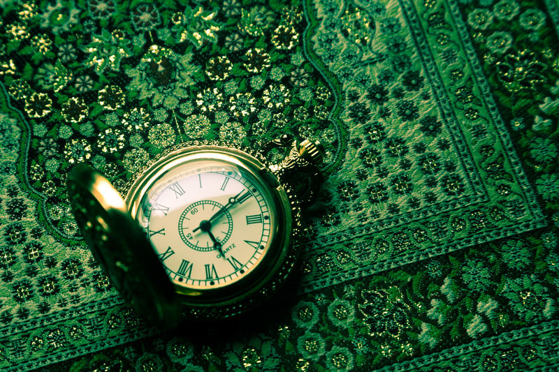 Clock Time Green Color Number Close-up No People Instrument Of Time High Angle View Watch Indoors  Antique Still Life Plant Pocket Watch Accuracy Communication Nature Technology Day Clock Face Personal Accessory Minute Hand