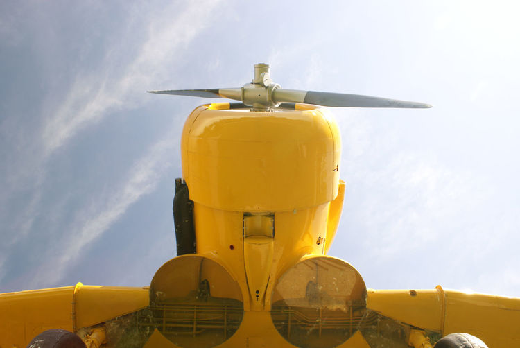 Low angle view of yellow airplane against sky