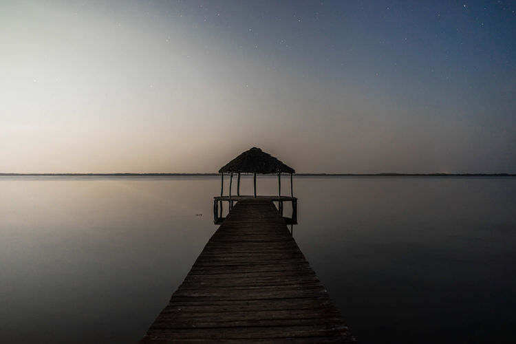 Empty jetty leading to sea