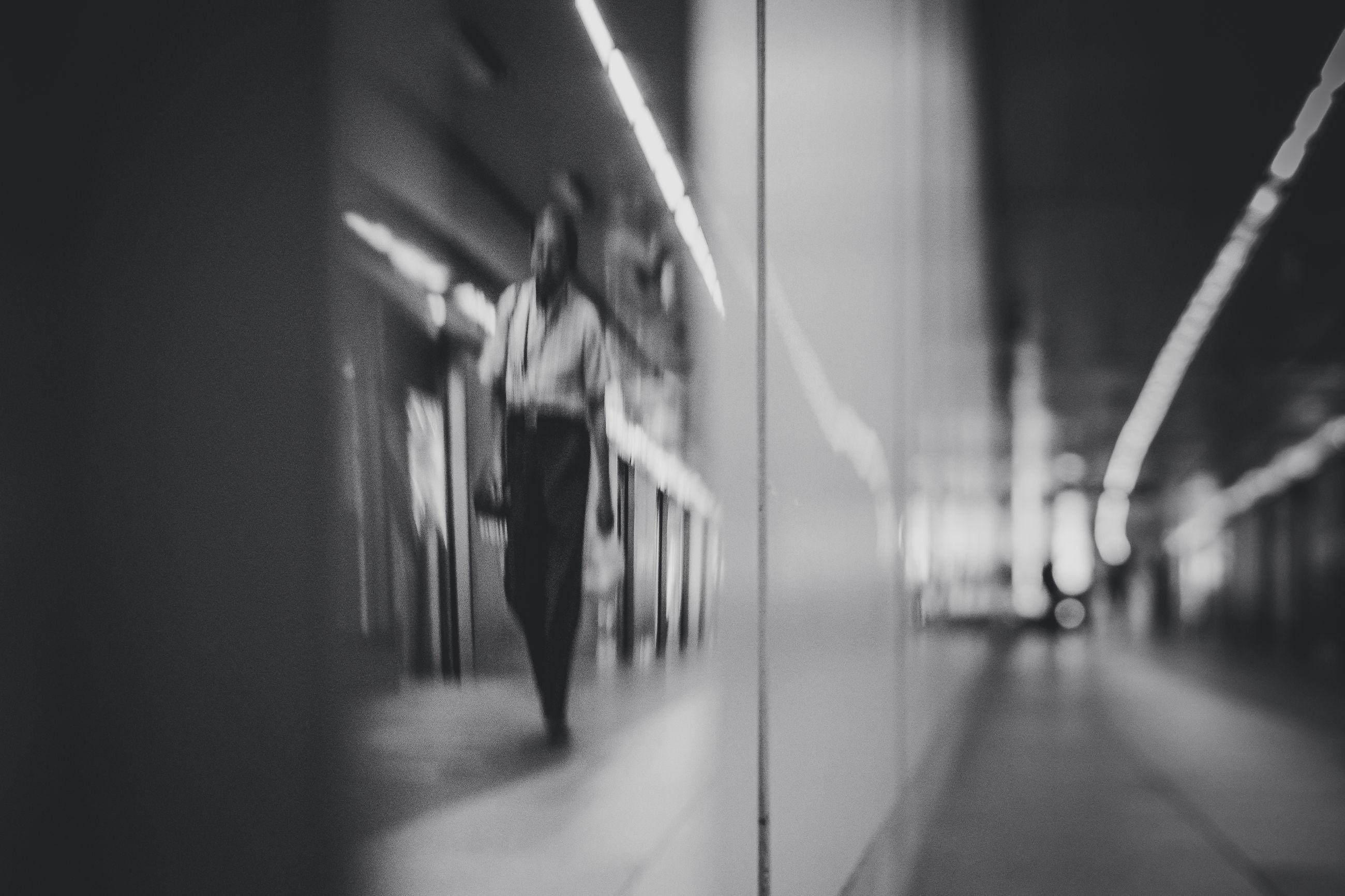 architecture, blurred motion, motion, selective focus, transportation, indoors, public transportation, rail transportation, train, no people, mode of transportation, train - vehicle, corridor, defocused, arcade, subway, railroad station platform, built structure, subway train