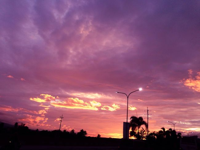 Sunset Silhouette Sky Cloud - Sky Outdoors Dramatic Sky Street Light Nature Beauty In Nature Tree Scenics Built Structure No People Building Exterior Electricity Pylon Architecture Day