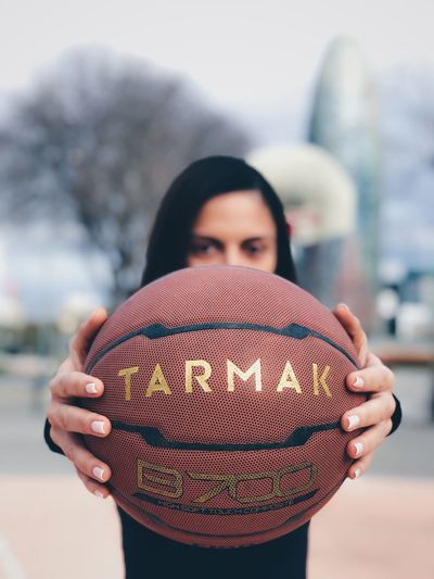 Fit Sports Basketball Ball Focus On Foreground One Person Holding Young Adult Day Real People Women Portrait Young Women Sky Human Hand Adult People