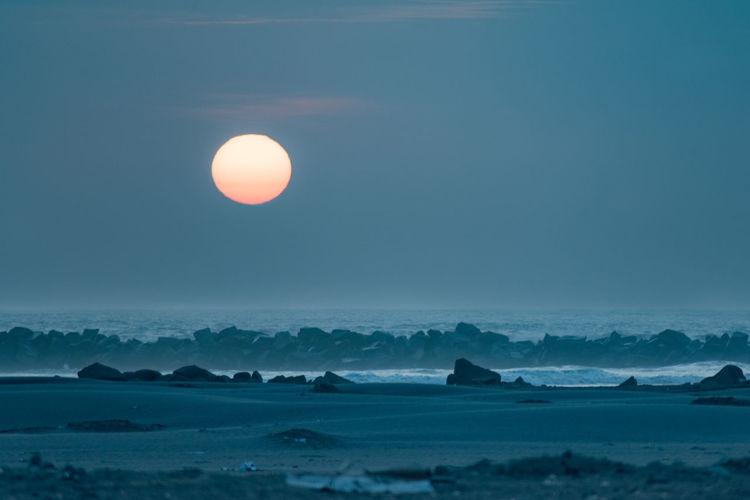 Full moon over sea at dusk