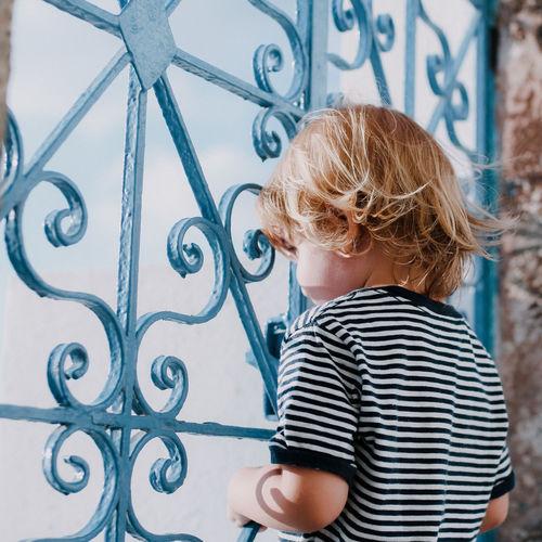 Childhood Kids Being Kids Children Only Children Photography Children's Portraits Castle Child Looking Away Fence Blue Blue Stripe Blue Hair Toddler  Looking Through Window Preschooler