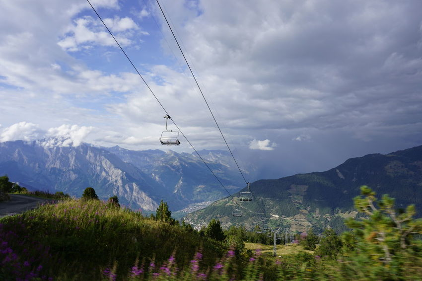 Beauty In Nature Cable Cable Car Cloud - Sky Day Environment Growth Landscape Mountain Mountain Range Nature No People Non-urban Scene Outdoors Overhead Cable Car Plant Scenics - Nature Sky Snowcapped Mountain Tranquil Scene Tranquility Tree