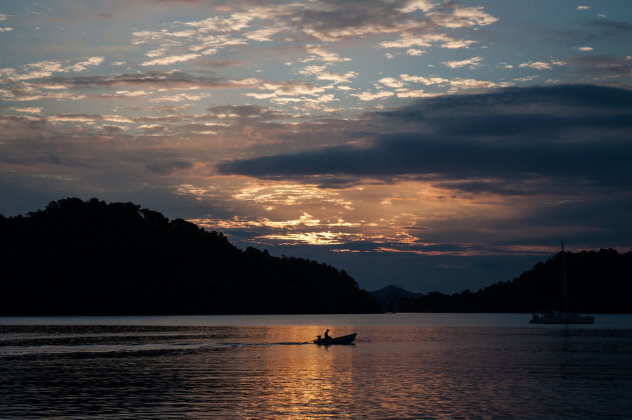 Beauty In Nature Boat Cloud - Sky Journey Mode Of Transport Mountain Mountain Range Nature Nautical Vessel No People Non-urban Scene Ocean Outdoors Sailing Scenics Sea Silhouette Sky Sunset Tourism Tranquil Scene Tranquility Transportation Water Waterfront
