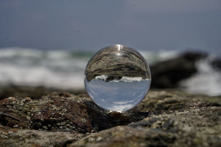 Nature Transparent Sphere Glass - Material No People Water Sky Solid Close-up Outdoors Day Reflection Rock Rock - Object Land Selective Focus Sea Environment Focus On Foreground
