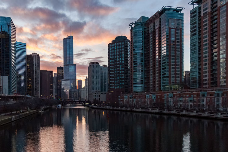 View of Chicago River reflecting a stunning winter sunset in March. Waysofseeing Chicago Chicago River Downtown Chicago Trump Tower Winter Architecture Building Exterior Built Structure City Cityscape Cloud - Sky Colorful Modern Outdoors Reflection River Sky Skyline Skyscraper Sunset Tall Travel Destinations Urban Skyline Water Waterfront