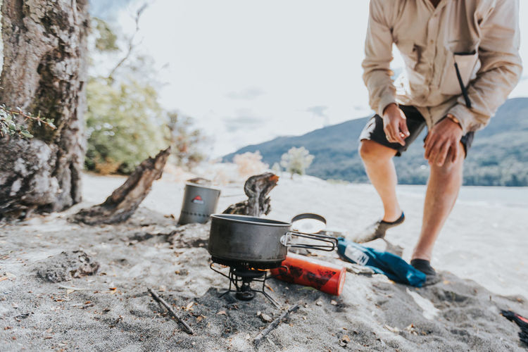 Adult Adults Only Adventure Camping Stove Day Holding Human Body Part Human Leg Low Section Mature Adult Mature Women Mountain One Person One Woman Only Only Women Outdoors People Standing Summer Vacation Destination Vacation Time Vacations Vacations Women Young Adult