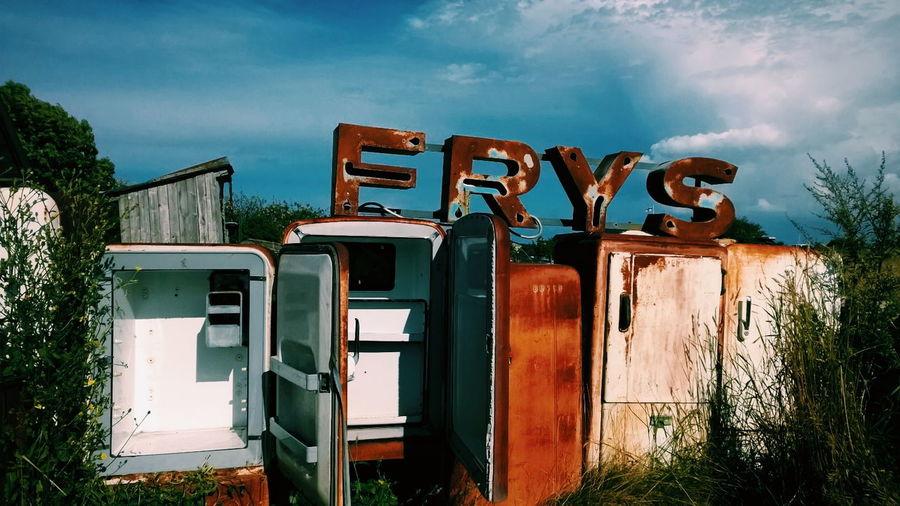 Rusty refrigerators in junkyard