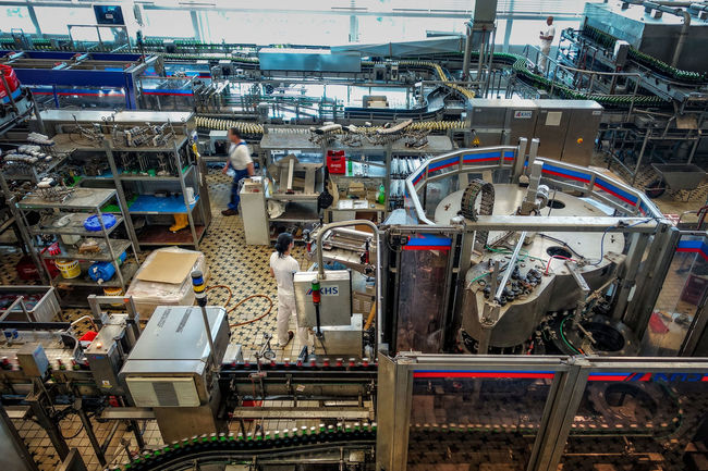 Ceske Budejovice, Czech Republic - June 30, 2016: Budvar Budweiser brewery. Bottle sorting, washing and beer bottling workshop with assembly-lines. Car Plant Complexity Day Factory Indoors  Industry Machinery Manufacturing Equipment No People Production Line Technology