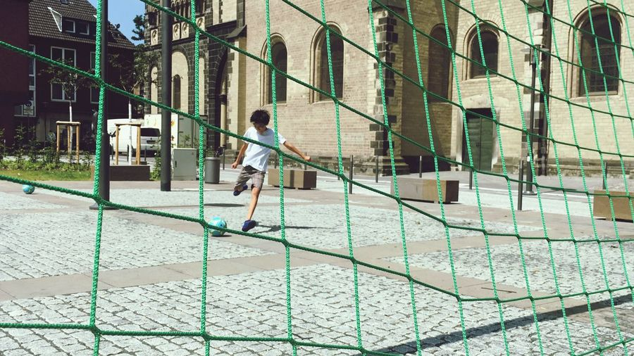 Football Fieber Football In The Street Football Fever Childhood Child Real People Full Length Playing Playground Day Lifestyles Leisure Activity Sport Casual Clothing Built Structure