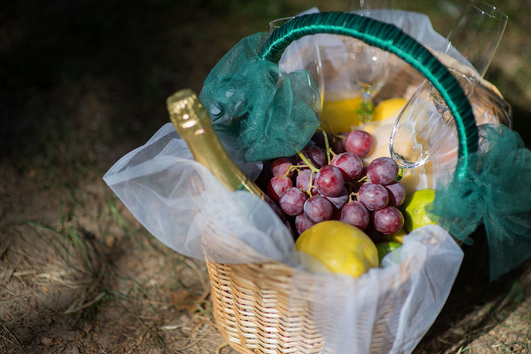 Champagne Glasses For Two Picnic Picnic Basket Romance Bag Basket Champagne Bottle Close-up Container Day Focus On Foreground Food Food And Drink Freshness Fruit Grapes Healthy Eating High Angle View No People Selective Focus Still Life Vegetable Wellbeing Wicker
