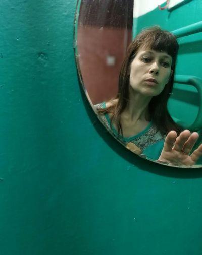 Woman reflecting on mirror