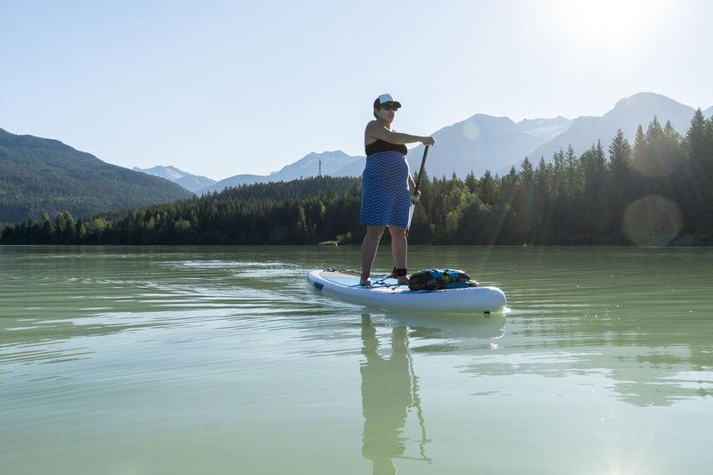 Full length of man on boat in lake against sky