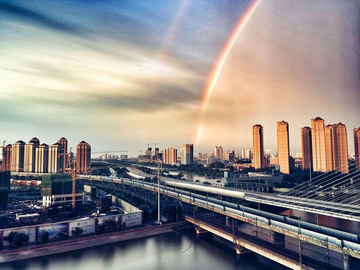 Panoramic View Of Rainbow Over City