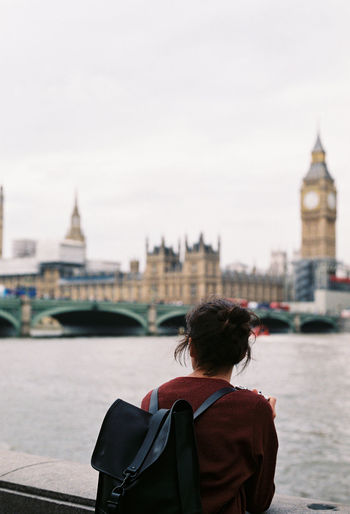 Rear view of woman with big ben in background