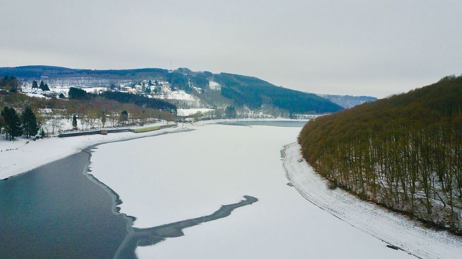 Winter Beauty In Nature Cold Temperature Snow Nature Scenics Tranquil Scene Tranquility Sky Mountain Non-urban Scene Clear Sky Idyllic Tree Outdoors Mountain Range Landscape Day Water Luxembourg DJI Mavic Pro Lultzhausen Stausee No People Beauty In Nature